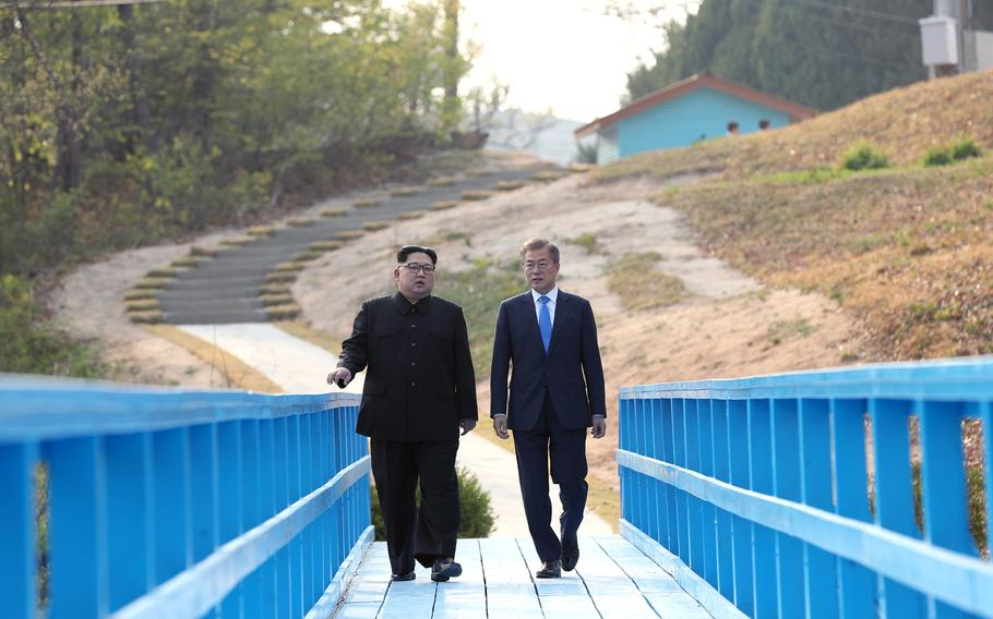 North Korean leader Kim Jong Un, left, walks with South Korean President Moon Jae-in during the Inter-Korean Summit on Friday, April 27, 2018.