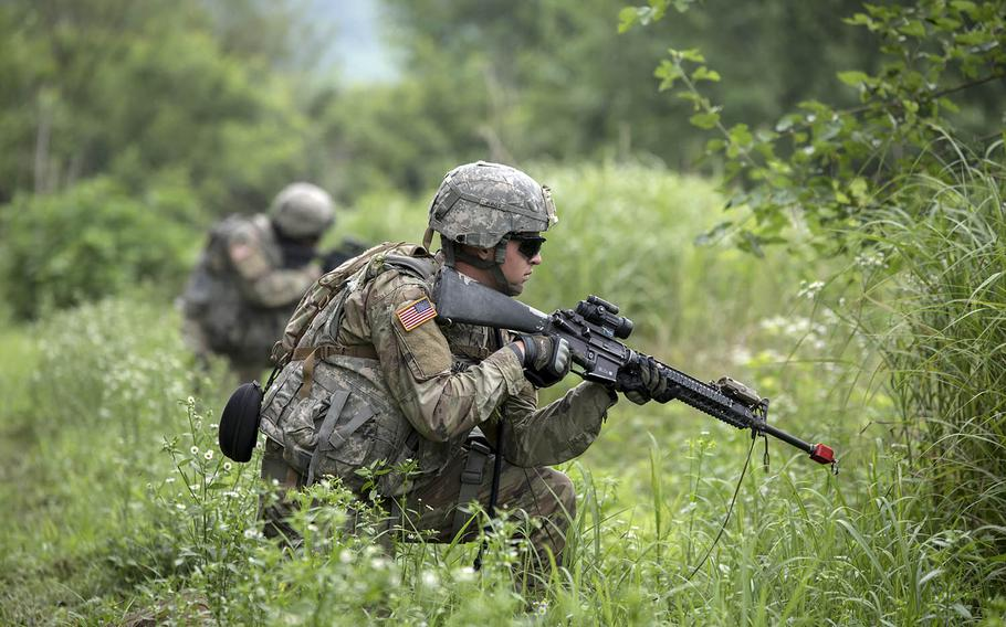 Soldiers from Bravo Company, 8th Brigade Engineer Battalion conduct a tactical road march during demolition training during the summer of 2017 in South Korea.