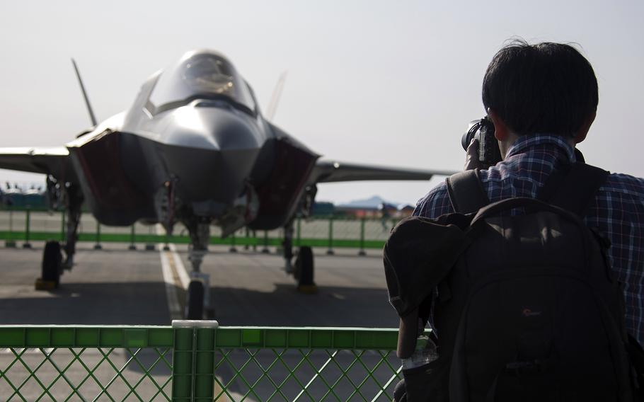 A man photographs an F-35B Lightning II on display during the 42nd annual Friendship Day at Marine Corps Air Station Iwakuni, Japan, Saturday, May 5, 2018.