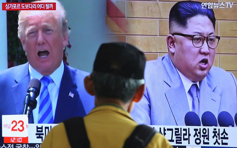 a man watches a TV screen at the Seoul Railway Station in Seoul, South Korea, on May 13, 2018, during a news program showing U.S. President Donald Trump, left, and North Korean leader Kim Jong Un.