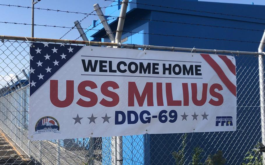 A sign welcomes the destroyer USS Milius to its new homeport at Yokosuka Naval Base on Tuesday, May 22, 2018.