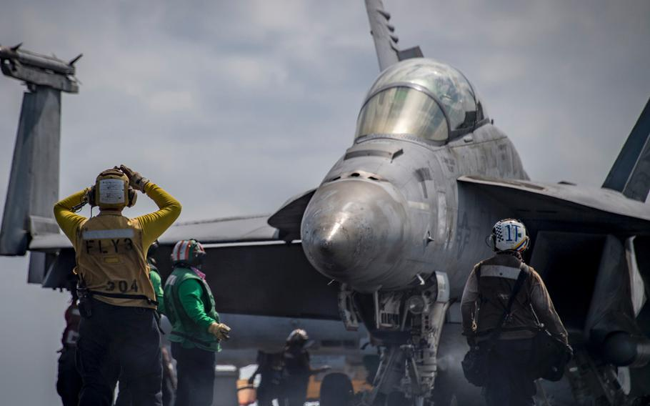 Sailors perform flight operations aboard the Nimitz-class aircraft carrier USS Carl Vinson (CVN 70), in the South China Sea on March 13, 2018.