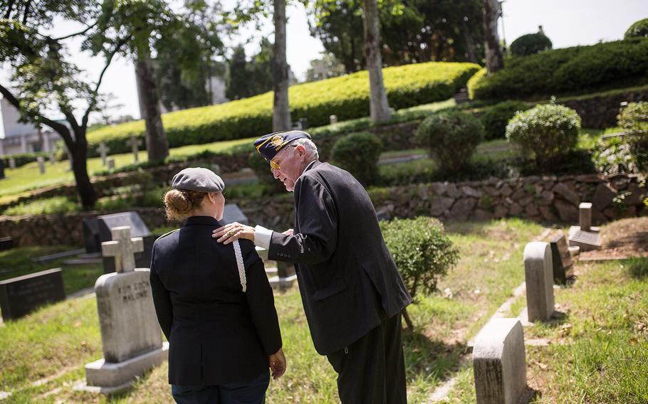 Chris Vaia, vice commander American Legion Post 38 talks to a JROTC cadet at Yanghwajin Cemetery in Seoul, South Korea, Monday, May 28, 2018.