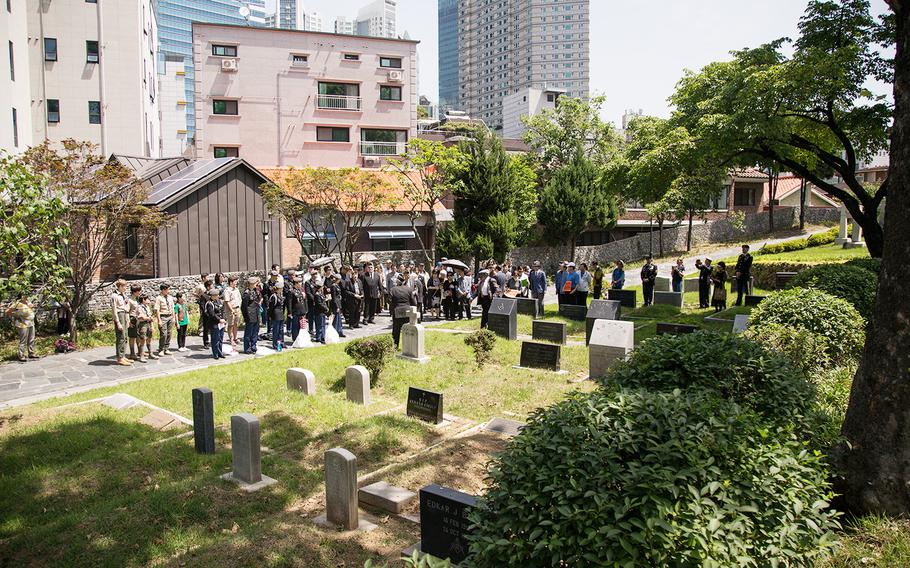 Americans and South Koreans pay respects to fallen U.S. servicemembers at Yanghwajin Cemetery in Seoul, South Korea, Monday, May 28, 2018.