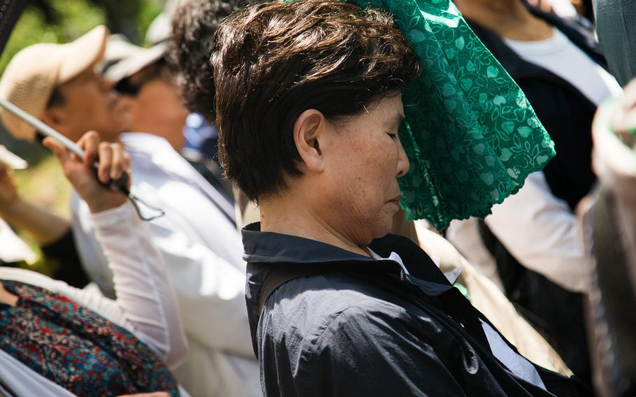 A South Korean women pays her respects to fallen U.S. servicemembers at Yanghwajin Cemetery in Seoul, South Korea, Monday, May 28, 2018.