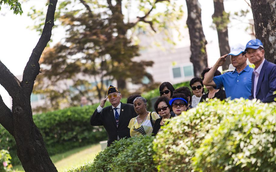 Americans and South Koreans salute the grave sites of fallen U.S. servicemembers at Yanghwajin Cemetery in Seoul, South Korea, Monday, May 28, 2018.