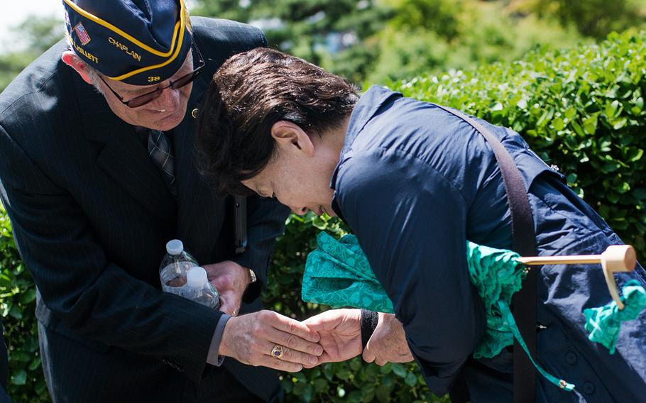 A South Korean says goodbye to an American Legion member at Yanghwajin Cemetery in Seoul, South Korea, Monday, May 28, 2018.
