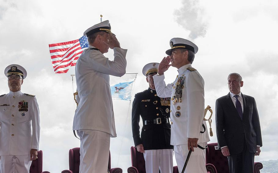 Adm. Phil Davidson, left, relieves Adm. Harry Harris, right, as commander of U.S. Pacific Command at Joint Base Pearl Harbor-Hickam on May 30, 2018.