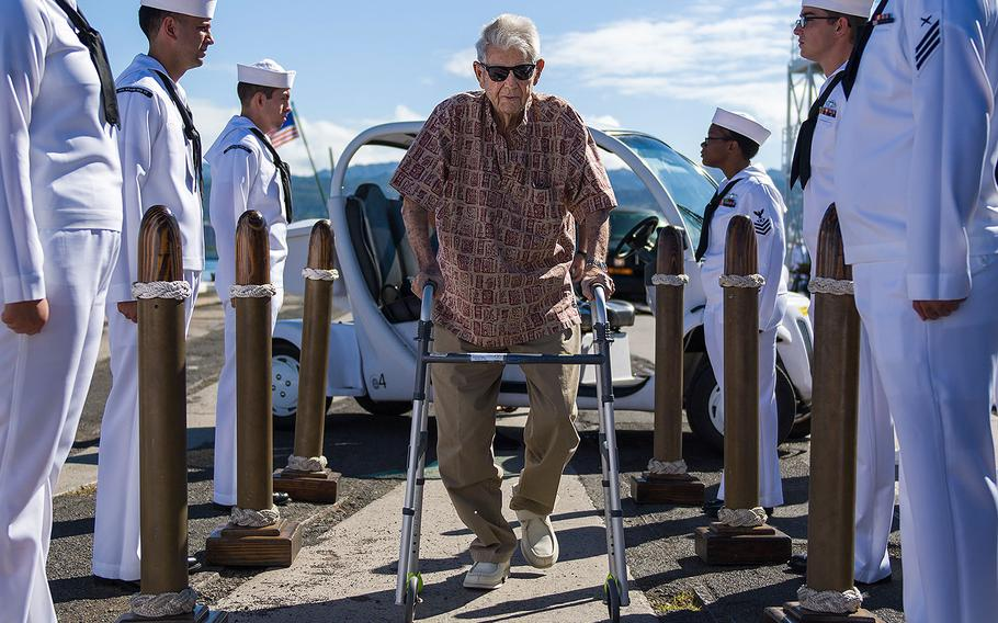 Retired Chief Boatswain's Mate and Pearl Harbor survivor Ray Emory is rendered honors by the sideboys during a farewell ceremony held before he departs Hawaii to be with family on June 19, 2018. Emory was responsible for the identification of unknown service members killed in the attacks on Pearl Harbor who were buried in unnamed graves.