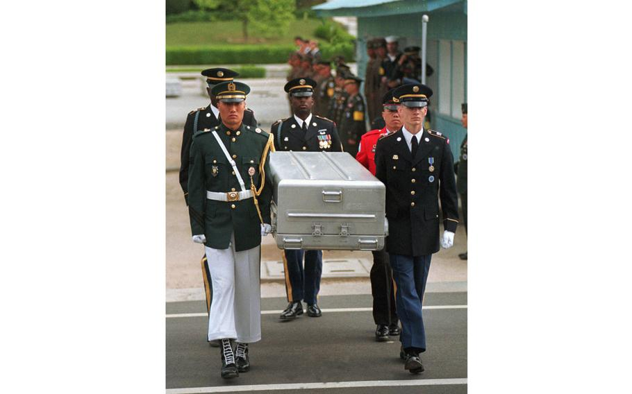 U.N. honor guards carry a coffin containing the remains of U.S. soldiers after it was returned from North Korea at the border village of Panmunjom, South Korea, on May 14, 1999. South Korean media reported that the U.S. military plans to send 215 caskets to North Korea through a border village on Saturday, June 23, 2018.