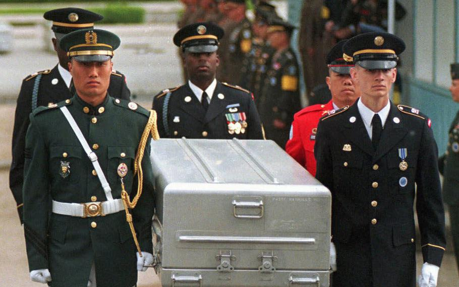 FILE- In this May 14, 1999, file photo, U.N. honor guards carry a coffin containing the remains of the American soldiers after it was returned from North Korea at the border village of Panmunjom, South Korea. South Korean media reported that the U.S. military plans to send 215 caskets to North Korea through a border village on Saturday, June 23, 2018, so that the North could begin the process of returning the remains of U.S. soldiers who have been missing since the 1950-53 Korean War. (AP Photo/Ahn Young-joon, File)