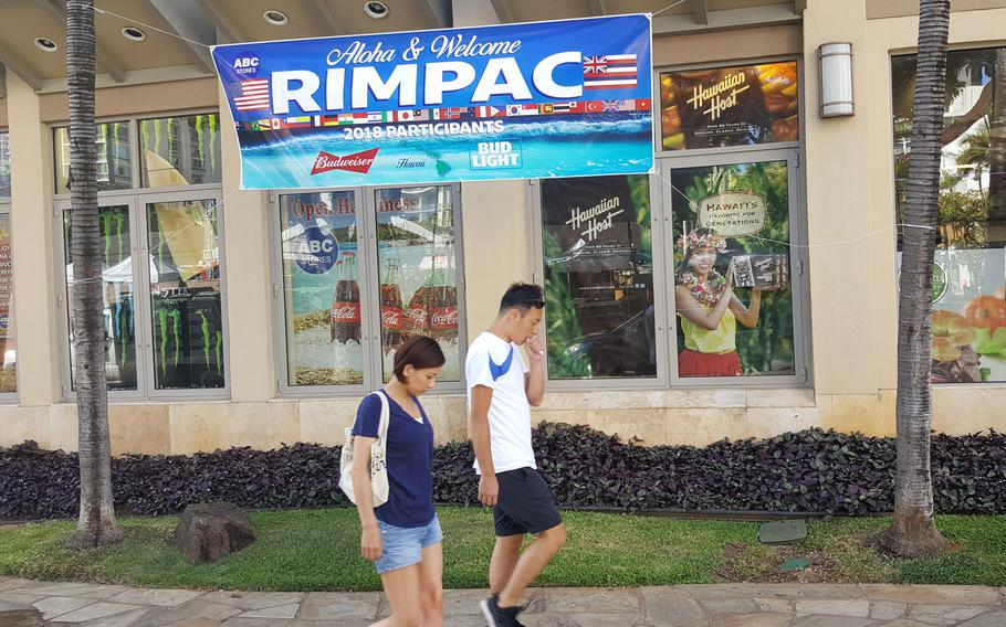 A banner displayed outside a convenience store on Waikiki Beach welcomes the thousands of mariners in Hawaii who have arrived for RIMPAC, which runs through Aug. 2.
