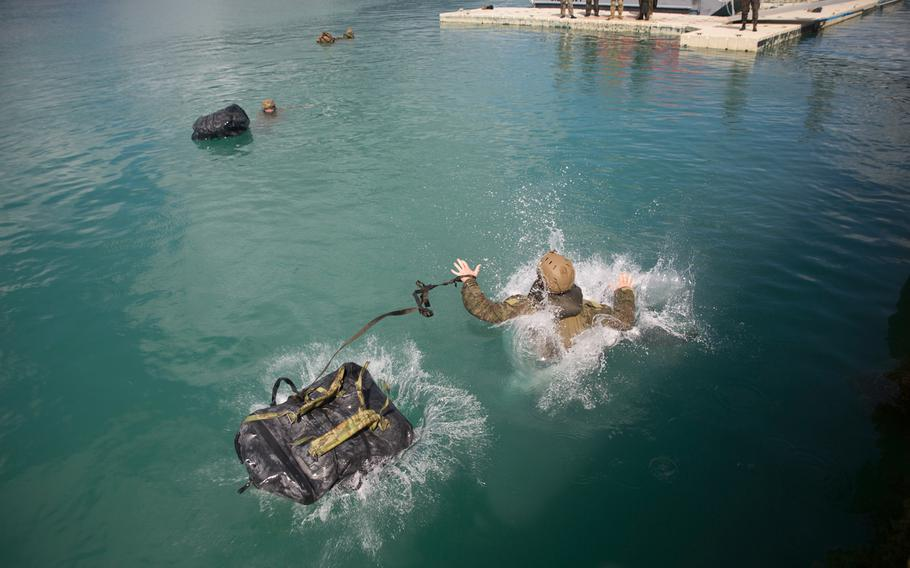 An Australian soldier swims to shore during a drill as part of the Rim of the Pacific exercise on Marine Corps Base Hawaii, June 29, 2018.