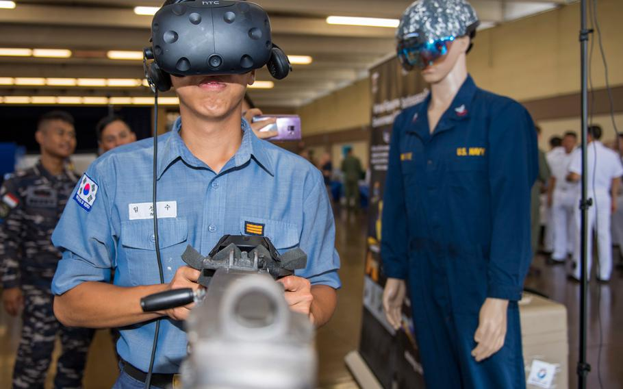 South Korean Navy Seaman Sung Su Im tries out BEMR Lab's virtual reality system at the Rim of the Pacific 2018 Innovation Fair held on Joint Base Pearl Harbor-Hickam, June 28, 2018.