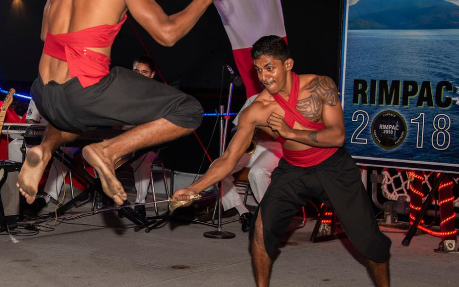 Sailors assigned to the Indian Navy frigate INS Sahyadri perform a traditional dance during a reception at Pearl Harbor July 5, 2018, as part of Rim of the Pacific exercise.