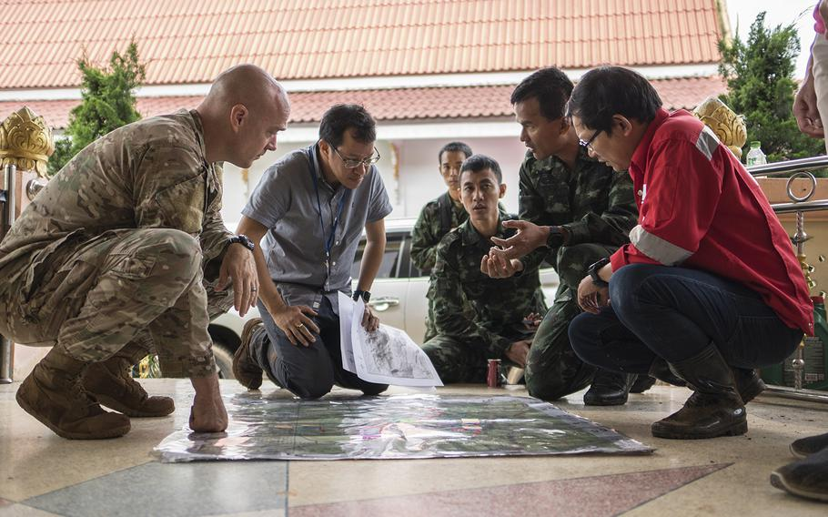 Airmen from the U.S. Indo-Pacific Command meet with Royal Thai military officials and a Thai engineering company to advise and assist in the rescue operation June 30, 2018, at Chiang Rai, Thailand. A search and rescue team was sent to Tham Luang cave in Northern Thailand at the request of the Royal Thai government to assist in the rescue of the missing Thai soccer players and their coach.