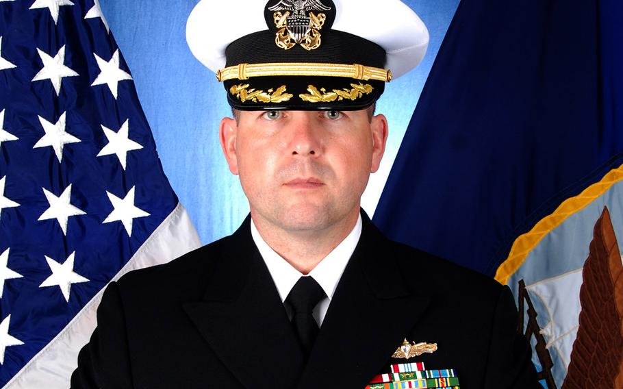 Navy Cmdr. Bryce Benson.