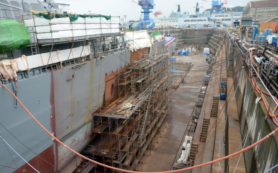 The USS John S. McCain is undergoing repairs in dry dock at Yokosuka Navy Base after her fatal collision last fall.