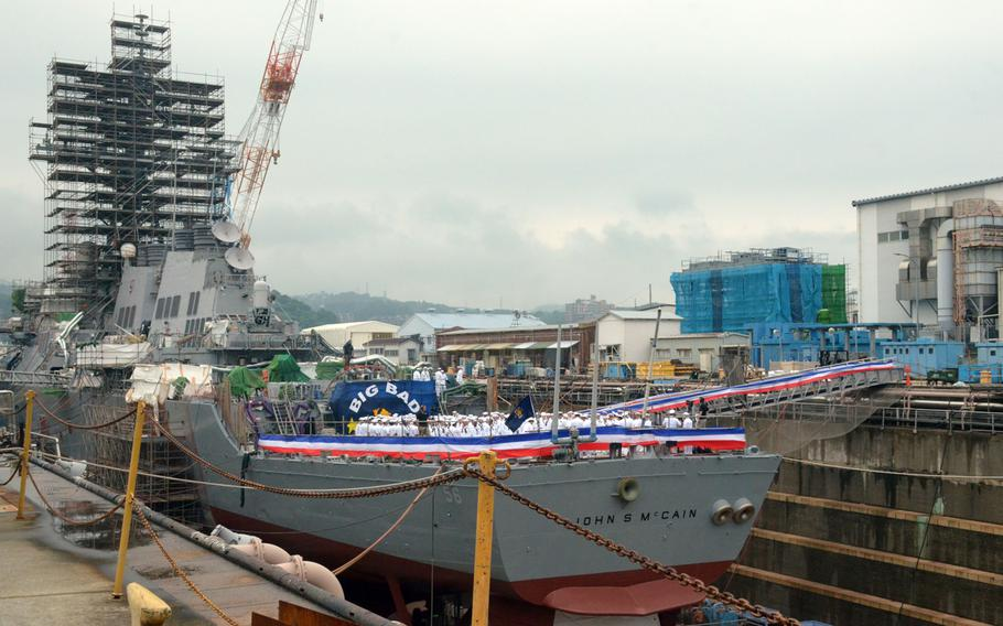 The USS John S. McCain was decorated in red, white and blue banners June 12, 2018 for the ship's rededication ceremony. About 265 sailors – nearly the ship's entire crew – stood on the McCain's deck for the ceremony.