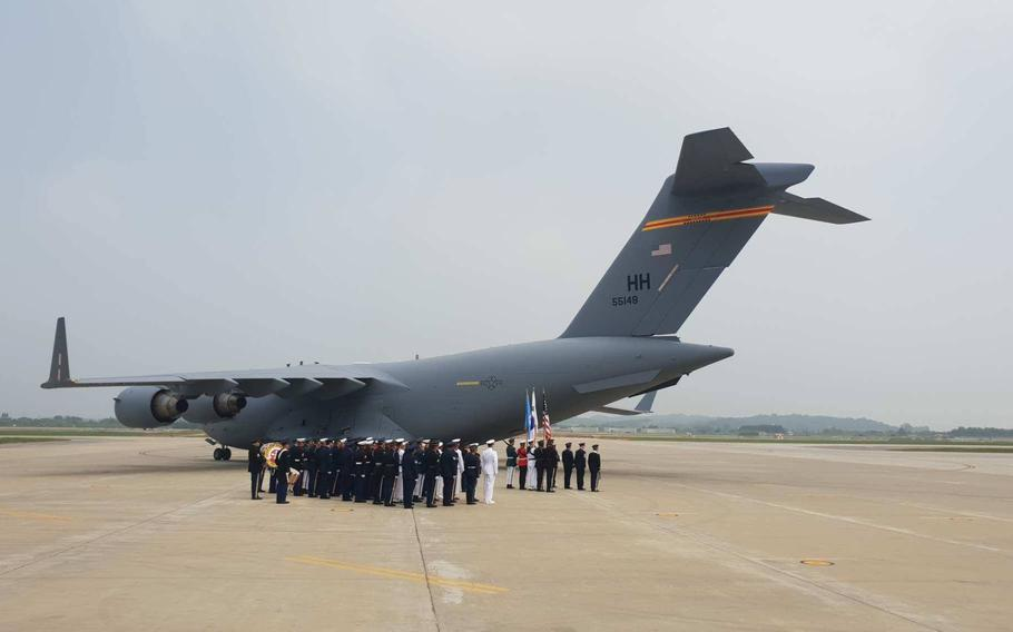 A C-17 carrying 55 cases of remains thought to be U.S. servicemembers killed in the Korean War returns to Osan Air Base, South Korea, Friday, July 27, 2018.
