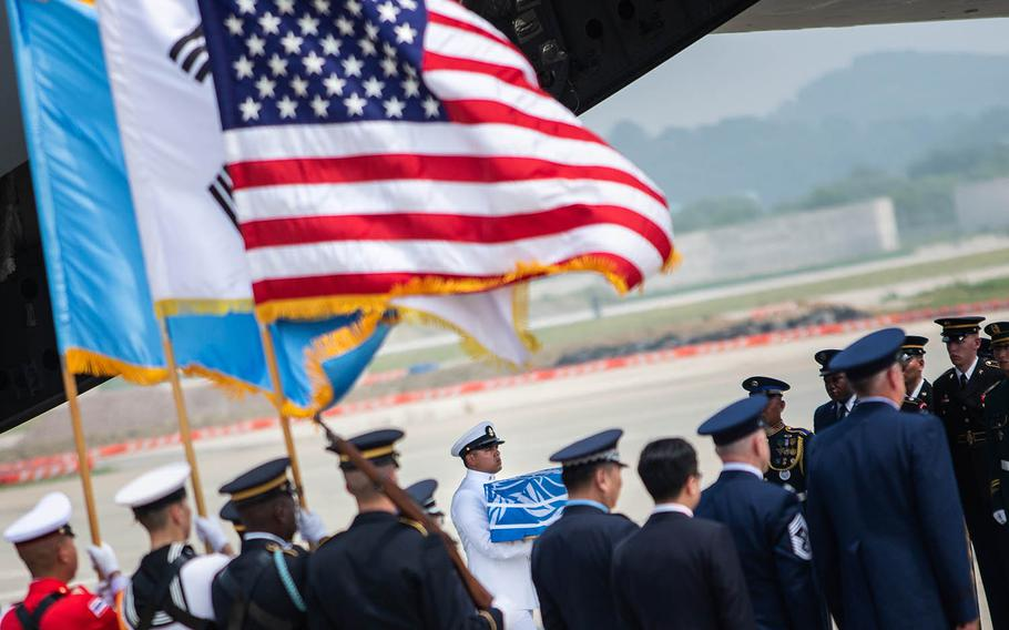 A case of remains repatriated from North Korea is carried off a C-17 Globemaster at Osan Air Base, South Korea, Friday, July 27, 2018.