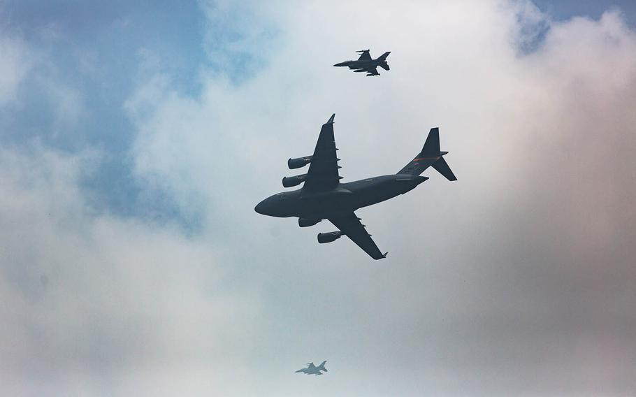 Escorted by fighter jets, a C-17 Globemaster arrives at Osan Air Base, South Korea, carrying 55 sets of remains handed over by North Korea, Friday, July 27, 2018.