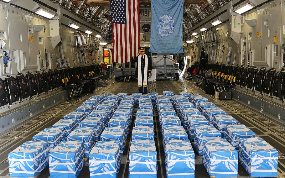 United Nations Command Chaplain U. S. Army Col. Sam Lee performs a blessing over 55 cases of remains returned by North Korea at Osan Air Base on Friday, July 27, 2018.