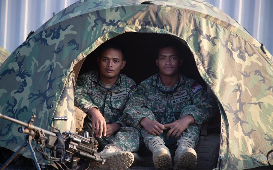 A pair of Malaysian Marines pose in their tent at Pohakuloa Training Area, Hawaii during the Rim of the Pacific exercise, July 15, 2018.