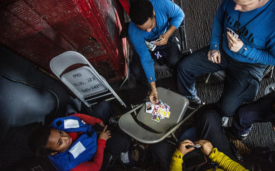 Sailors play UNO aboard the USS Carl Vinson off the coast of Hawaii during the Rim of the Pacific exercise, July 21, 2018.