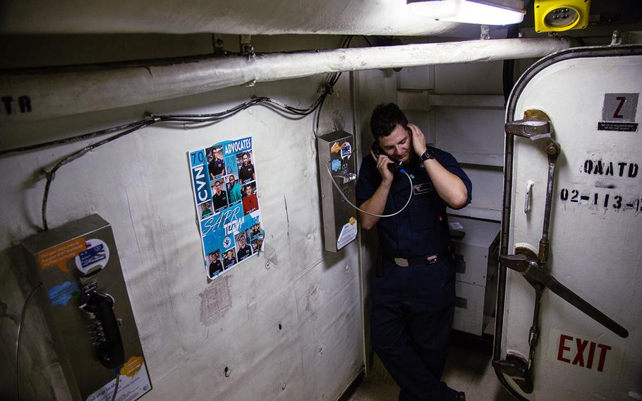 A sailor makes a phone call aboard the USS Carl Vinson off the coast of Hawaii during the Rim pf the Pacific exercise, July 21, 2018.