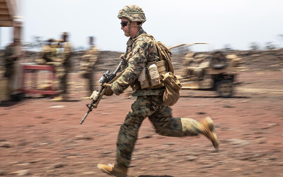 A Marine runs across a range at Pohakuloa Training Area, Hawaii during the Rim of the Pacific exercise, July 18, 2018.