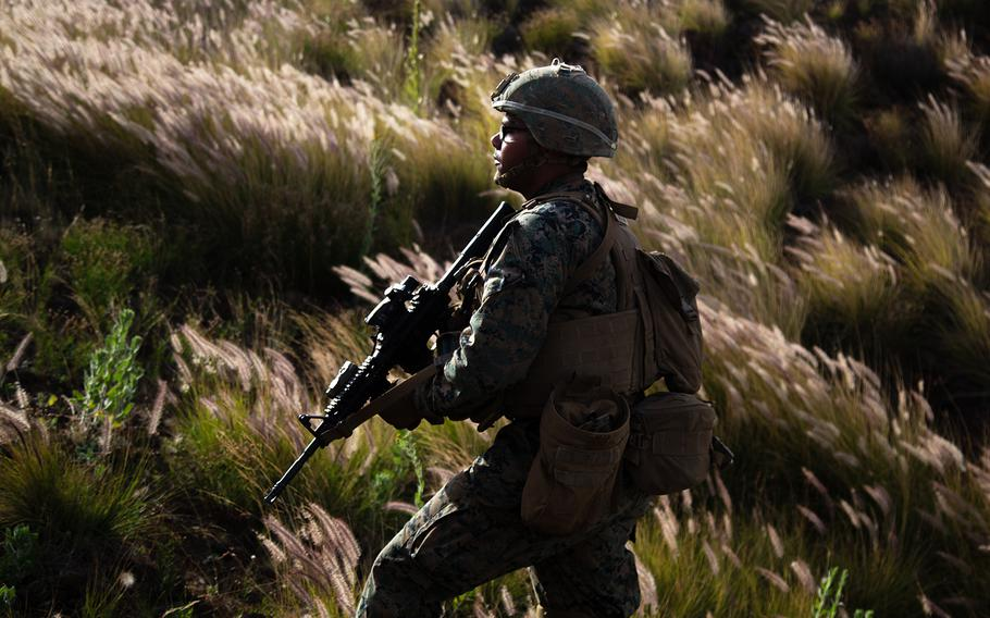 A Marine patrols a range at Pohakuloa Training Area, Hawaii during the Rim of the Pacific exercise, July 13, 2018.