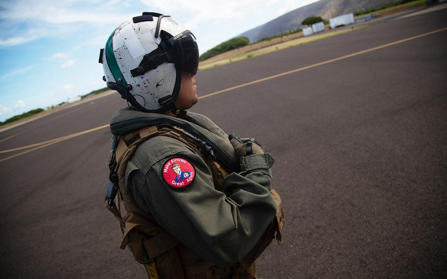 """A Navy helicopter crew chief wears a """"Make Aircrew Great Again"""" morale patch at Barking Sands Pacific Missle Range, Hawaii, July 12, 2018."""