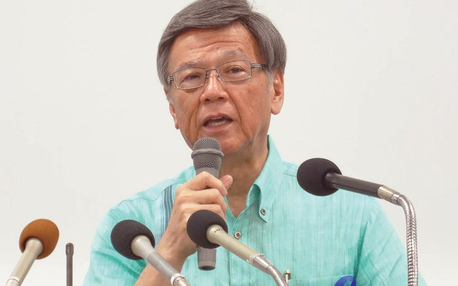 Okinawa Gov. Takeshi Onaga speaks to reporters during a rally in 2015 against a plan to move Marine Corps air operations from urban Futenma to the island's remote north.