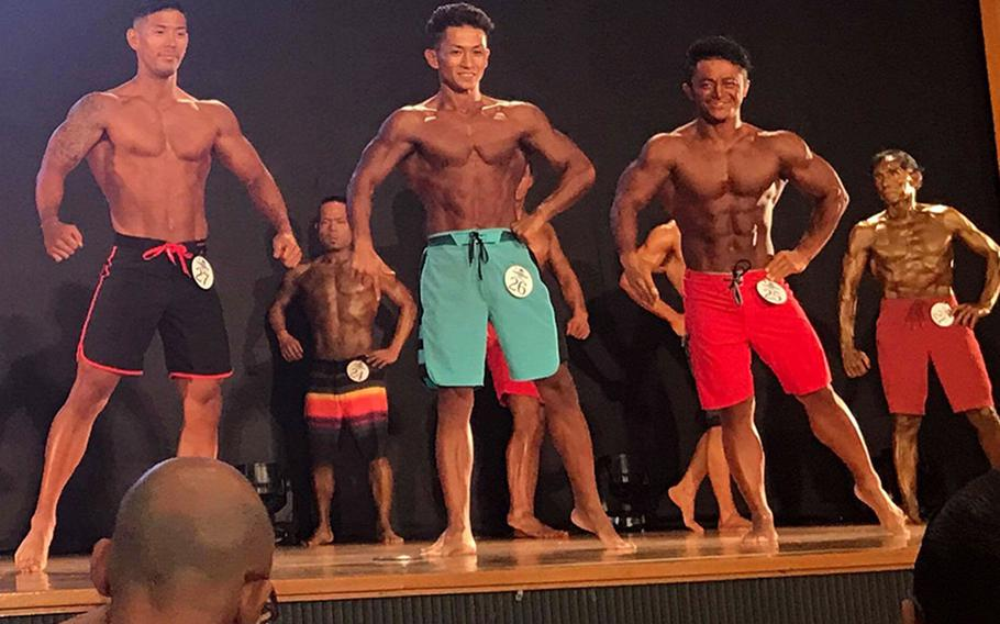 Contestants pose during the19th annual Far East Bodybuilding Competition at Camp Foster, Okinawa, Sunday, Aug. 5, 2018.
