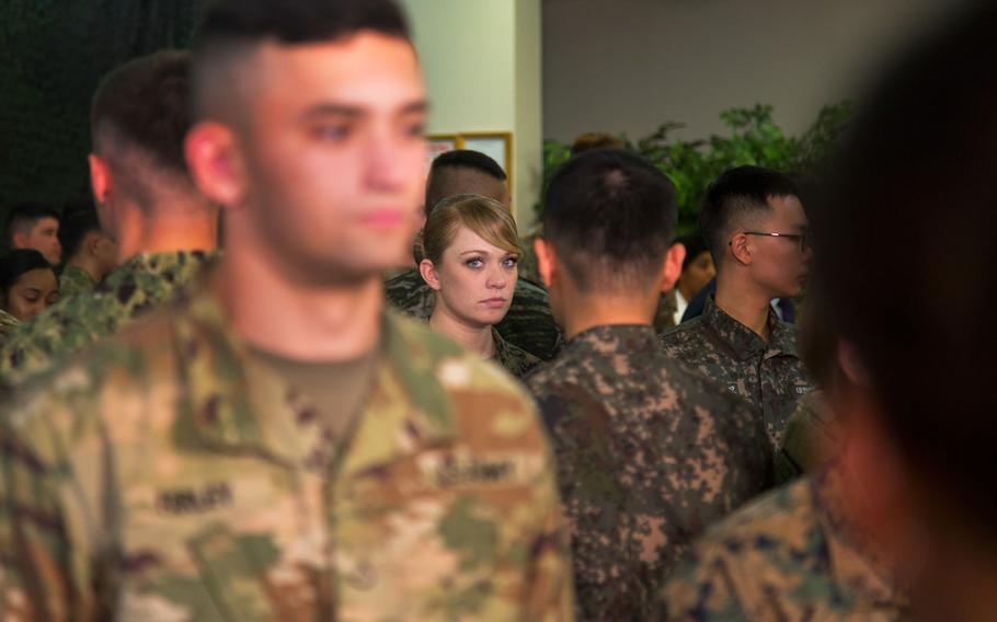 Troops wait for U.S. and South Korean leaders to arrive for lunch at Camp Humphreys, South Korea, Tuesday, Nov. 7, 2017.