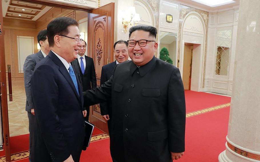 North Korean leader Kim Jong Un, right, meets with South Korean envoys in Pyongyang, North Korea, Wednesday, Sept. 5, 2018.
