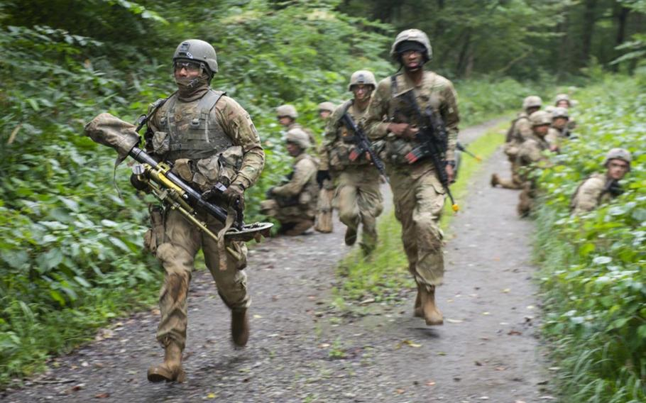 Soldiers from the Indiana National Guard's 76th Infantry Brigade Combat Team run to a new position during the field training exercise portion of Orient Shield 2018.