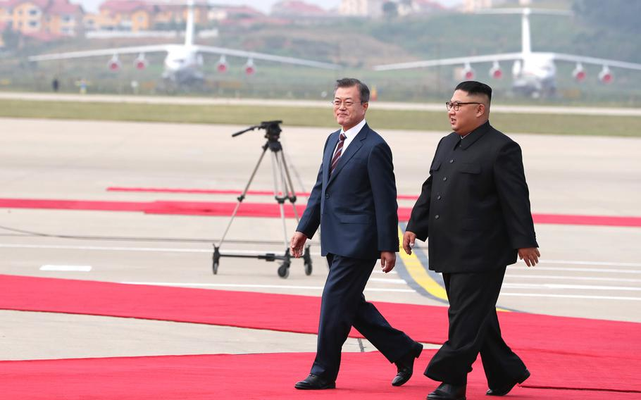 South Korean president Moon Jae-in (left) and North Korean leader Kim Jong Un meet in North Korea on Sept. 18, 2018.