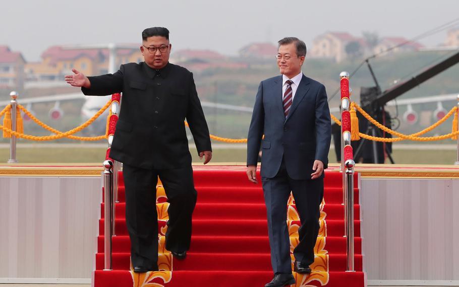 South Korean president Moon Jae-in (right) and North Korean leader Kim Jong Un meet in North Korea on Sept. 18, 2018.