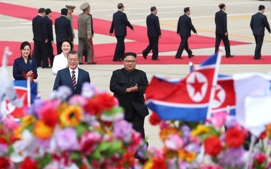 South Korean president Moon Jae-in (left) and North Korean leader Kim Jong Un meet in North Korea for a summit on Sept. 18, 2018.