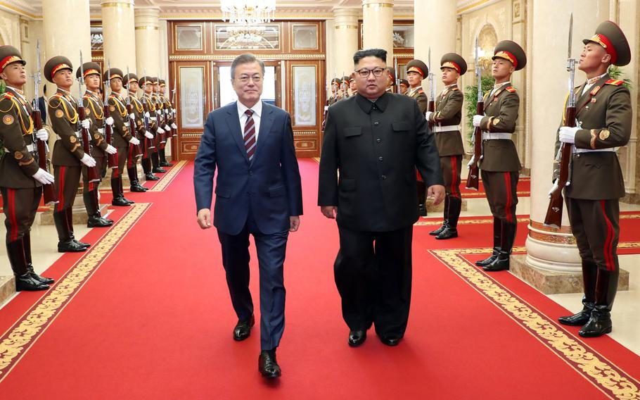 South Korean president Moon Jae-in (left) and North Korean leader Kim Jong Un arrive at the headquarters of the Central Committee of the Workers' Party of Korea in Pyeongyang, North Korea on Sept. 18, 2018.