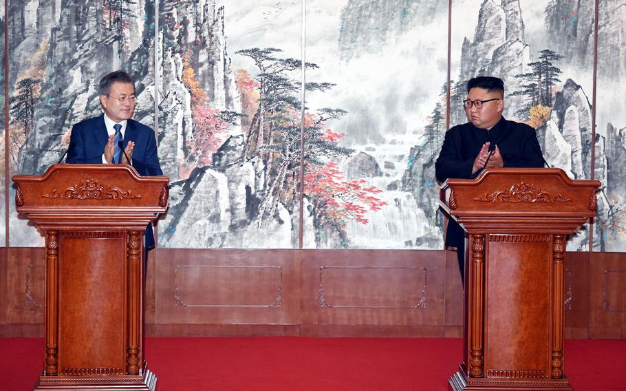 South Korean President Moon Jae-in, left, and North Korean leader Kim Jong Un clap during a joint press conference at the Paekhwawon State Guesthouse in Pyongyang, North Korea on Wednesday, Sept. 19, 2018.