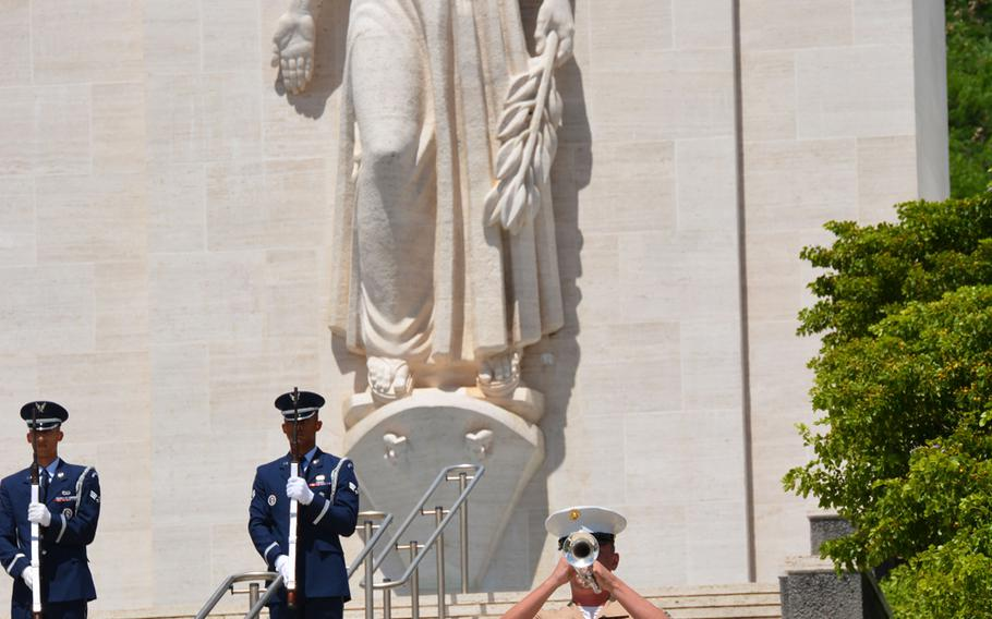 Taps is played near the Court of Honor's Lady Liberty statue at the National Memorial Cemetery of the Pacific during the conclusion of a ceremony recognizing National POW/MIA Recognition Day Sept. 21, 2018.
