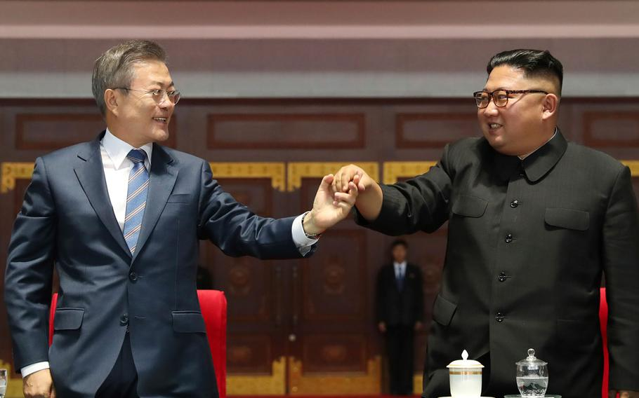 """South Korean President Moon Jae-in and North Korean leader Kim Jong Un hold their hands together after watching the mass games performance of """"The Glorious Country"""" at May Day Stadium in Pyongyang, North Korea, Wednesday, Sept. 19, 2018."""