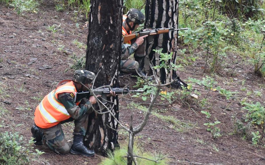 Indian army soldiers pull security during a search and destroy demonstration during Yudh Abhyas Sept. 24, 2018, at Chaubattia Military Station, India.