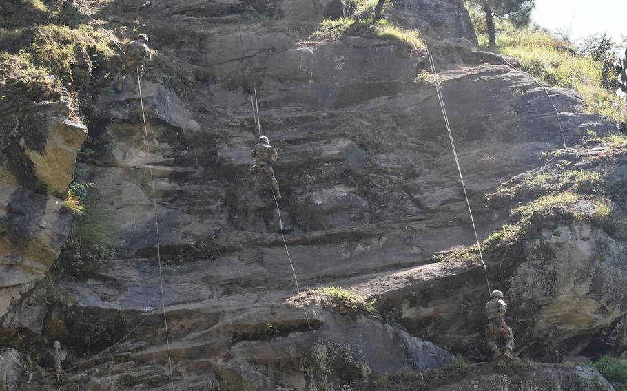 Soldiers with 1st Battalion, 23rd Infantry Regiment, rappel down a cliff Sept. 20, 2018, during Yudh Abhyas at Chaubattia Military Station, India.