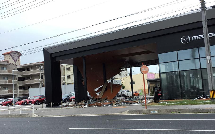 The roof of a car dealer in Chatan, Okinawa was damaged in Typhoon Trami over the weekend. Trami, the 28th numbered storm and fifth super typhoon of the season, battered Okinawa with 103-mph sustained winds and 132-mph gusts overnight Saturday into Sunday morning.