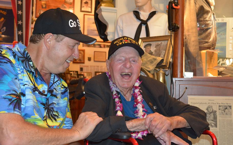 World War II veteran Sidney Walton, 99, and son Paul share a laugh during a stop at the Home of the Brave Museum, Honolulu, Oct. 5, 2018, shortly after meeting with Hawaii Gov. David Ige.