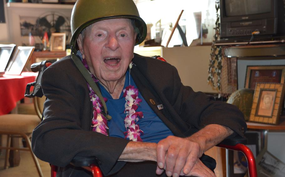 Sidney Walton, 99, poses in a World War II Army helmet at the Home of the Brave Museum in Honolulu, Oct. 5, 2018, just one stop in his 50-state No Regrets Tour.